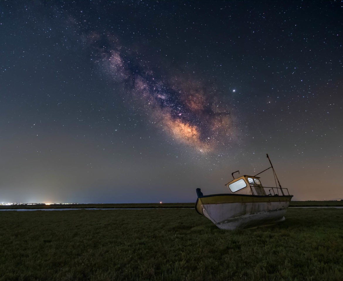 An old boat under the milky way