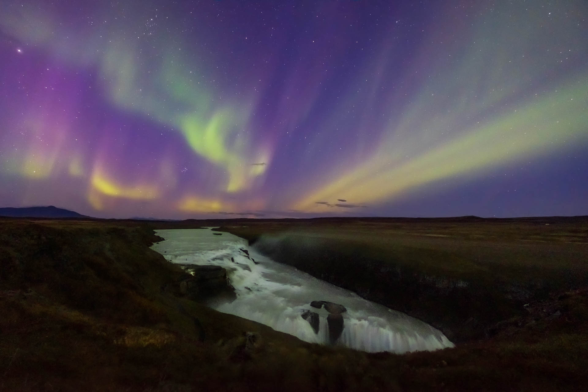 Aurora Borealis over Gullfos waterfall