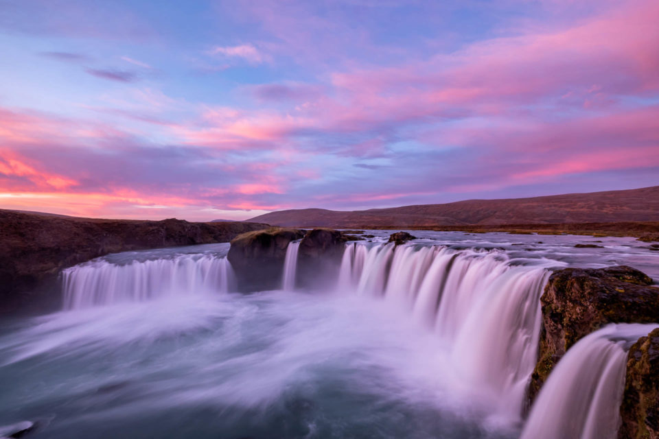 Long exposure of Godafoss waterfall in Iceland during a colorful sunrise