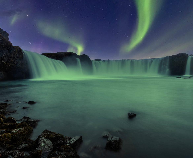 Aurora Borealis over Godafoss waterfall in Iceland