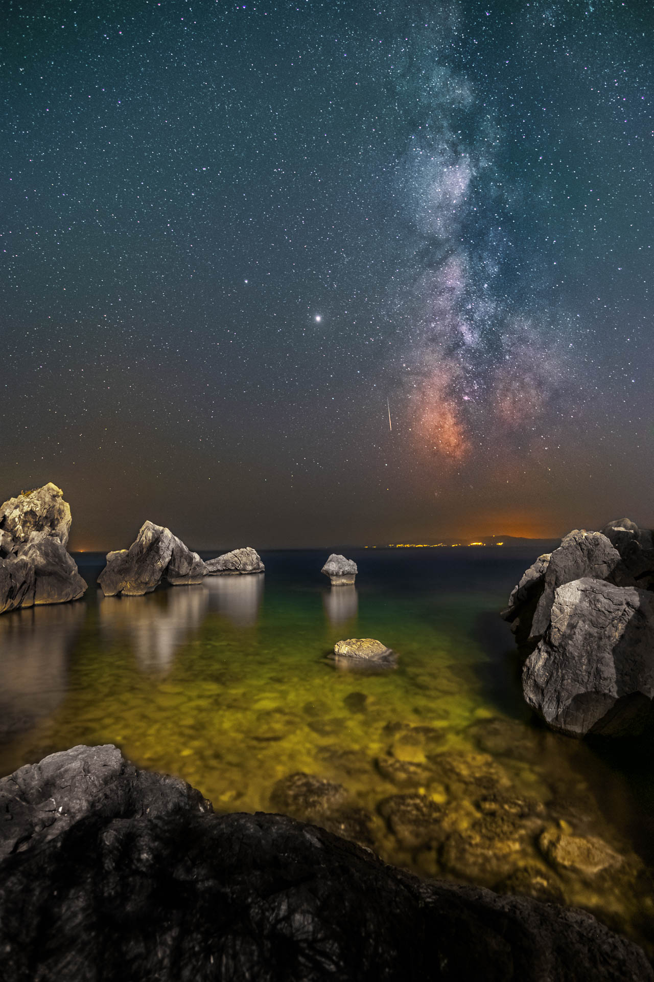 Seascape with perseids meteor shower in front of the mikly way core