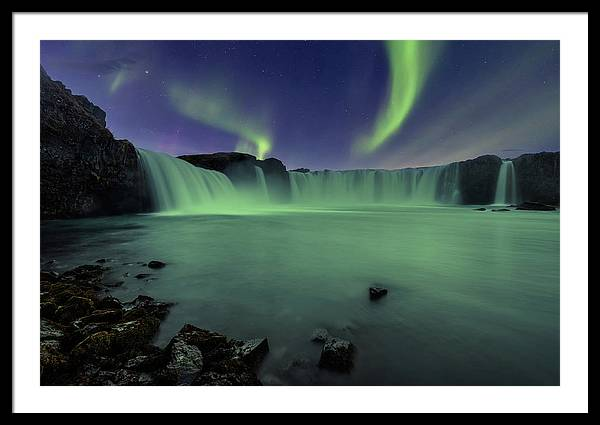 Aurora Borealis over Godafoss Waterfall in Iceland